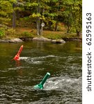 Two navigational buoys in fast river - stock photo