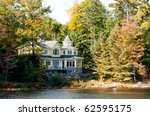 Summer home in autumnal setting - stock photo