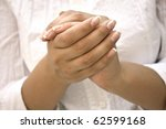 hands positioned as in prayer... | Shutterstock . vector #62599168