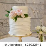 white wedding cake with pink... | Shutterstock . vector #626022941