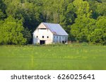 White Barn In Summer Time In...