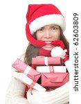 Christmas shopping woman stress. Young shopper holding christmas gifts / presents stressed, frustrated and angry. Funny woman biting her santa hat and arms full of gifts. Isolated on white background. - stock photo