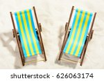 two sunbeds on the beach  top...   Shutterstock . vector #626063174