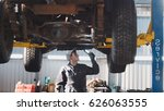 mechanic with thr lamp is... | Shutterstock . vector #626063555