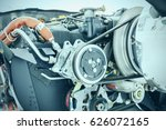 Small photo of Aircraft engine detail. Piece of equipment of the aircraft engine closeup, View of an aircraft engine.
