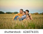 happy parents with children at... | Shutterstock . vector #626076101