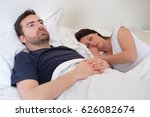 sad and depressed man lying in... | Shutterstock . vector #626082674