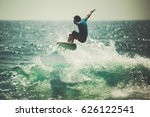 surfer on the wave. the surfer... | Shutterstock . vector #626122541