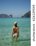 girl on the beach looking at... | Shutterstock . vector #626139545