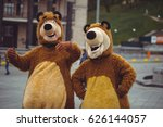 two men in a bear costume in... | Shutterstock . vector #626144057