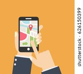 hand holds smartphone with city ...   Shutterstock .eps vector #626150399