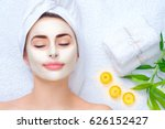 Spa woman applying facial clay...
