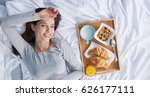 happy brunette having breakfast ... | Shutterstock . vector #626177111