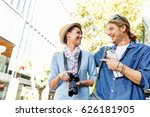 smiling couple with the camera | Shutterstock . vector #626181905