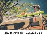men installing kayak on the rv... | Shutterstock . vector #626226311