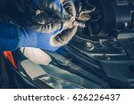 Headlight Bulb Repair and Maintenance in the Auto Service. Maintaining Car Lightning. Repair Vehicle Concept. - stock photo
