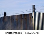 barbed wire on the metal wall... | Shutterstock . vector #62623078