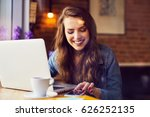 happy woman with laptop at cafe ... | Shutterstock . vector #626252135