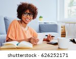 young woman calculating bills... | Shutterstock . vector #626252171