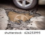 large potholes in montreal ... | Shutterstock . vector #626253995