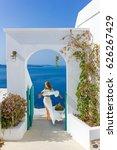 woman in santorini greece | Shutterstock . vector #626267429