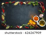 herbs and spices over black... | Shutterstock . vector #626267909