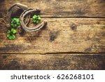 Stock photo st patrick s day horseshoe and shamrock on wooden background 626268101