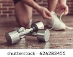 dumbbells in the foreground ... | Shutterstock . vector #626283455