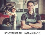 at the auto service. handsome... | Shutterstock . vector #626285144