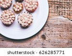 tasty cupcakes on a old wooden... | Shutterstock . vector #626285771