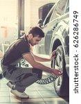 handsome young auto mechanic in ... | Shutterstock . vector #626286749