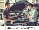at the auto service. handsome... | Shutterstock . vector #626286755
