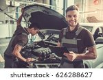 handsome young auto mechanics... | Shutterstock . vector #626288627