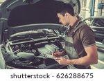 handsome young auto mechanic in ... | Shutterstock . vector #626288675