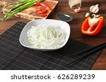plate with rice noodles on...