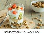 a glass of yogurt layered...   Shutterstock . vector #626294429
