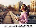 happy young woman listening to...   Shutterstock . vector #626298827