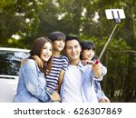 asian family with two children... | Shutterstock . vector #626307869