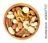 Raw Mixed Nuts In Wooden Bowl....