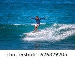surfer on a long board.... | Shutterstock . vector #626329205