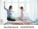 young mother and her little... | Shutterstock . vector #626335424