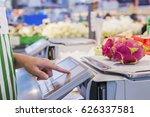 the seller is weighing fruit... | Shutterstock . vector #626337581