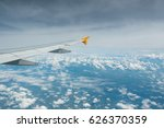 wing of an airplane flying...   Shutterstock . vector #626370359