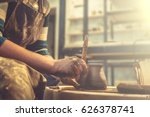 young woman potter in apron at... | Shutterstock . vector #626378741