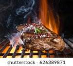 tasty beef steaks on the grill... | Shutterstock . vector #626389871