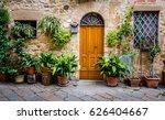 plants surround doorway in... | Shutterstock . vector #626404667