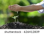 children's hands watering a... | Shutterstock . vector #626412839
