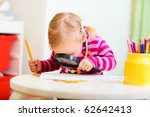 Funny photo of adorable toddler girl looking through magnifier - stock photo