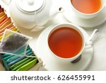 tea cups and tea pot and a box... | Shutterstock . vector #626455991