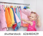 cute small girl in wardrobe... | Shutterstock . vector #626483429